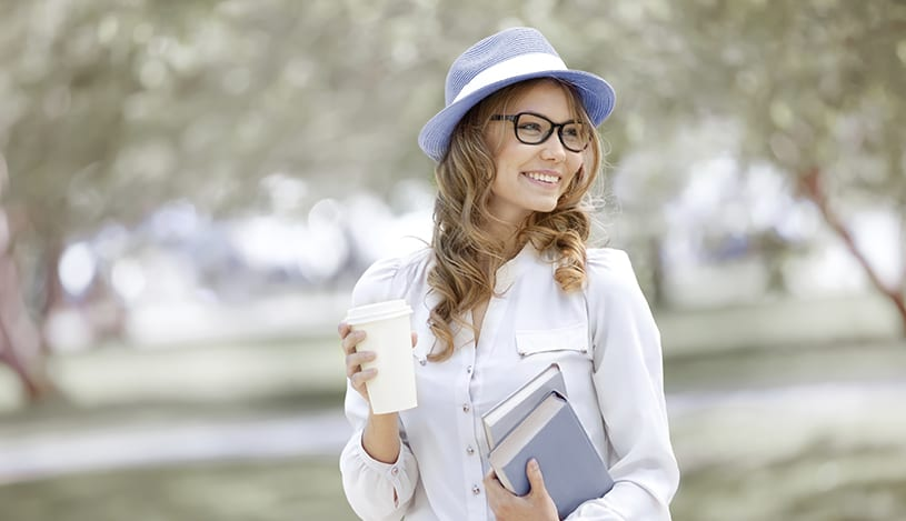 Happy Young Woman With Coffee Cup, Walking In A Summer Park And Holding Books v2