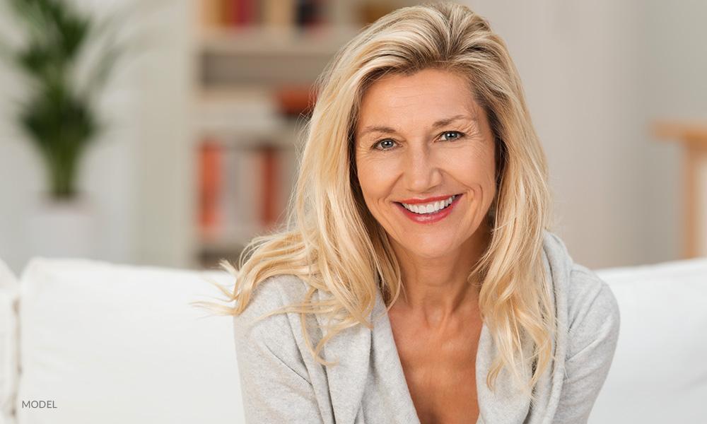 mature-blonde-woman-in-grey-sweater-1