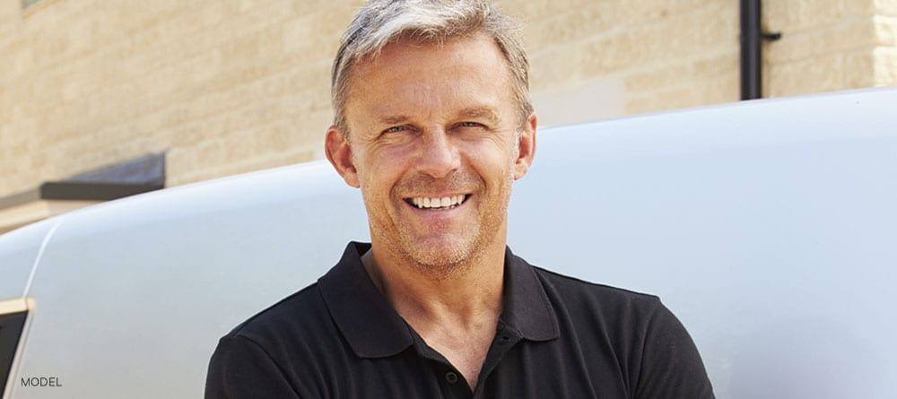 Mature Male In Black Polo Smiling