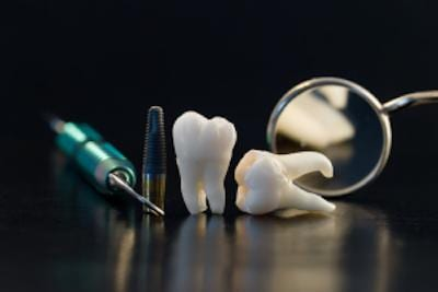 Extracted Teeth and Tools