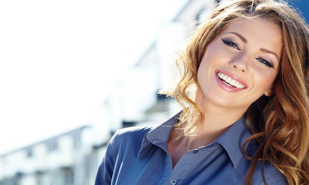 Happy Young Woman in Button Shirt