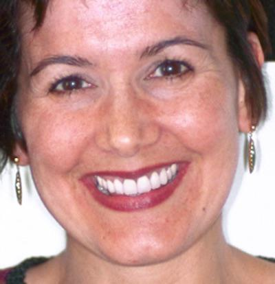 Headshot of Smiling Woman with Earrings