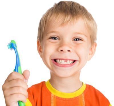 Little Boy Holding Toothbrush