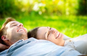 Young-Couple-Lying-on-the-Grass